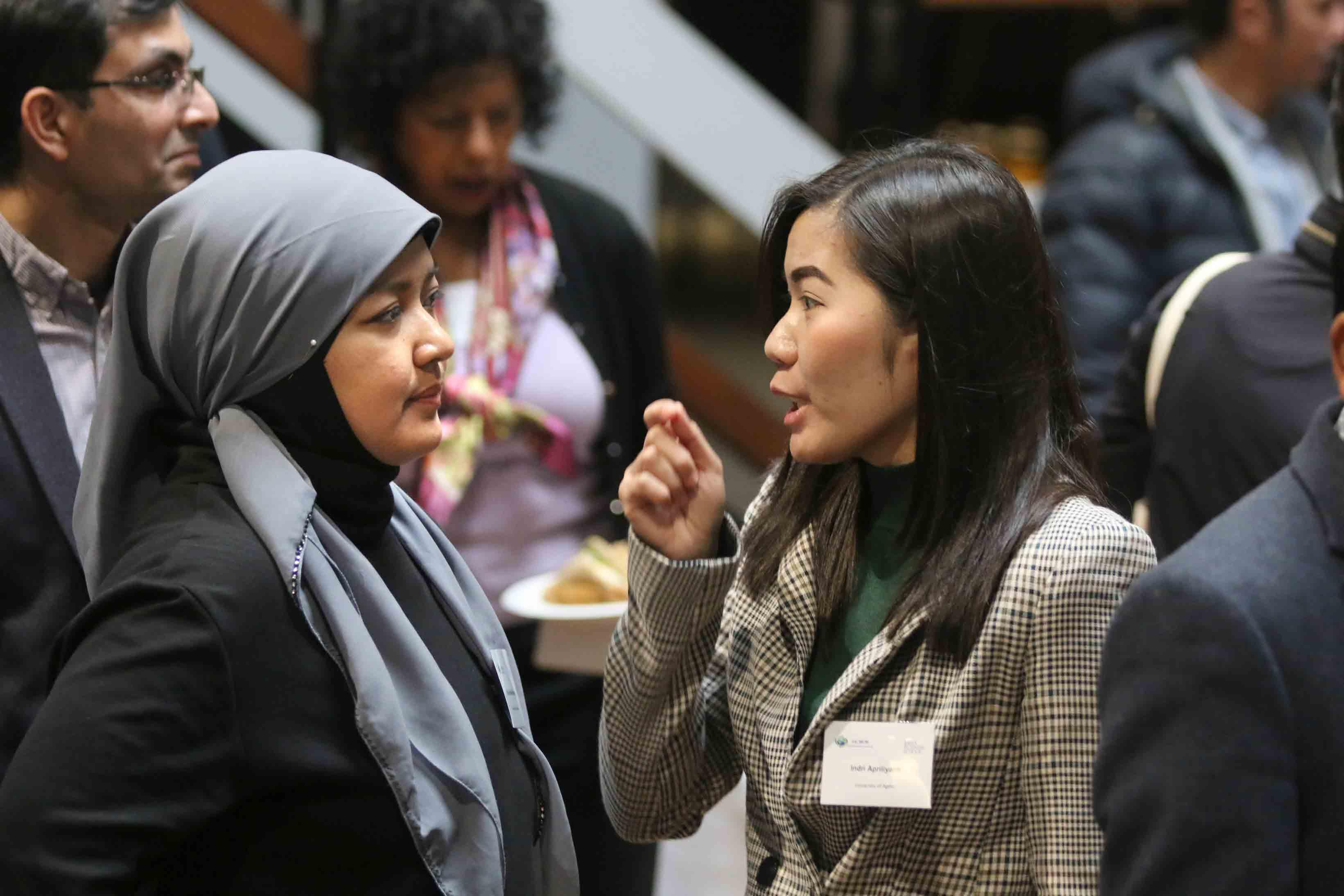 Conference attendee Dian Kartika Rahajeng and Indri Apriliyanti